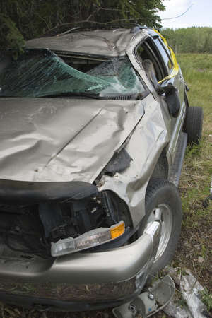 Large SUV after rollover photo