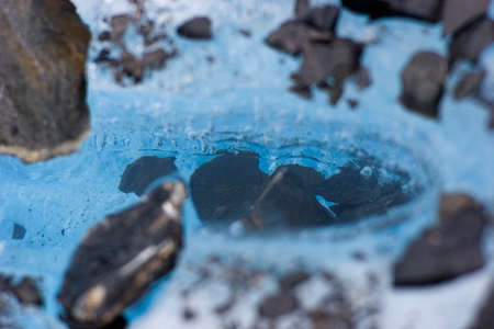 disintegrate: The rock heats up on sun, melting ice around it. This is one of the ways glaciers disintegrate