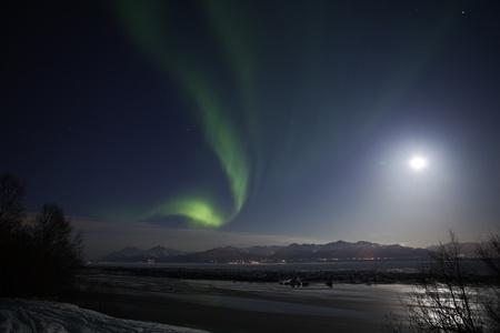 aurora polaris: Active Northern Lights over Cook Inlet and Chugach mountains in southcentral Alaska, March 2012