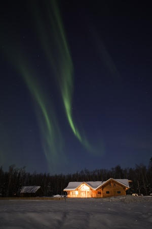 Strong northern lights display over alaskan residence in March 2012 photo