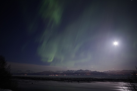 Active Northern Lights over Cook Inlet and Chugach mountains in southcentral Alaska, March 2012 photo