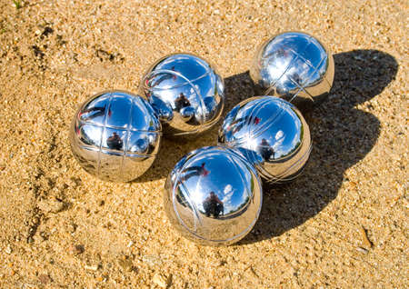 playing the french petanque, balls on the ground  Stock Photo