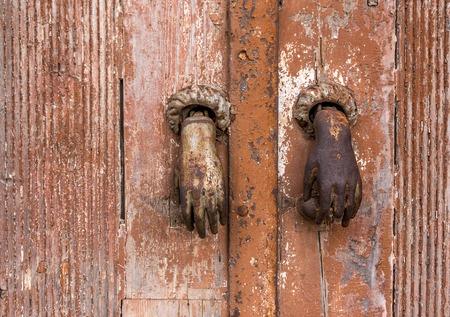 doorknocker: Old bronze knocker on a wooden door
