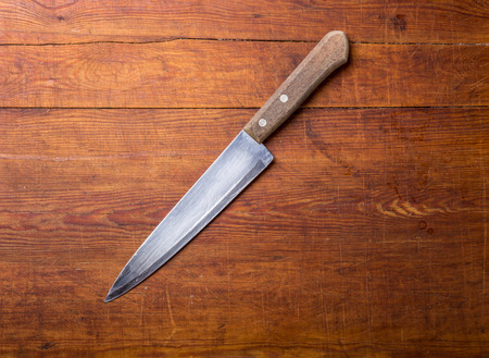 rustic kitchen: Knife on rustic kitchen table with copy space