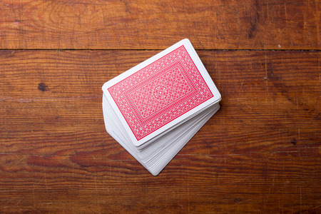 deck of cards on wooden table Stock Photo