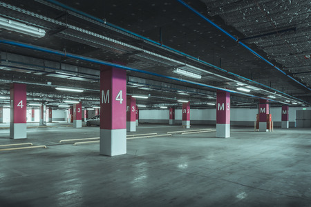 parking lot interior: Empty parking lot wall. Urban, industrial background. Stock Photo