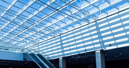 steel building: The glass roof of the station in the sunlight Stock Photo
