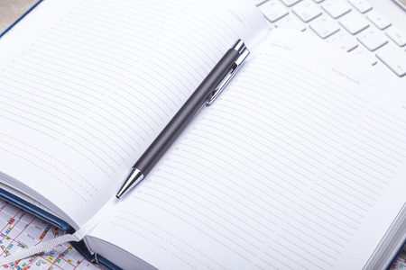 blank space: Blank notepad with pen on office table