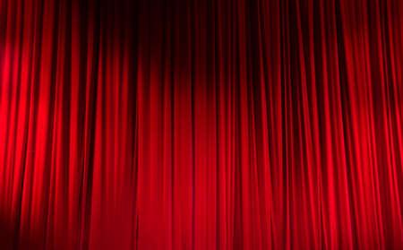 cortinas rojas: Red cerró la cortina con puntos de luz en un teatro.