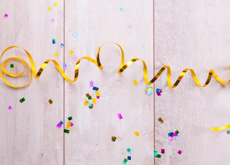 childrens birthday party: Wooden board with colorful streamers.