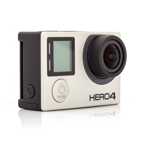 cam gear: MOSCOW, RUSSIA- june 29, 2015: GoPro Hero 4 Black Edition isolated on white background.manufactured by GoPro Inc.pro,