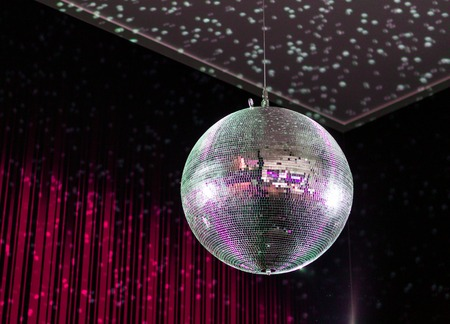 disco background: Shining disco ball on red background.
