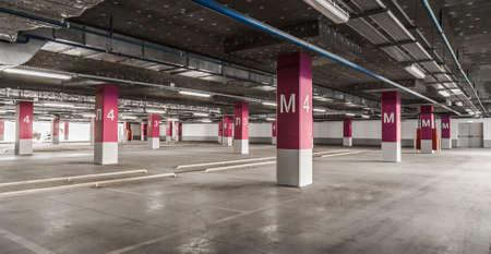 parking lot interior: Underground garage - parking lot in a basement of house.
