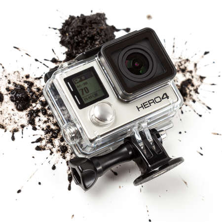 cam gear: MOSCOW, RUSSIA- june 29, 2015: GoPro Hero 4 Black Edition on muddy background. Manufactured by GoPro Inc.pro, Editorial