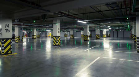 parking garage: Parking garage, underground interior with a few parked cars.