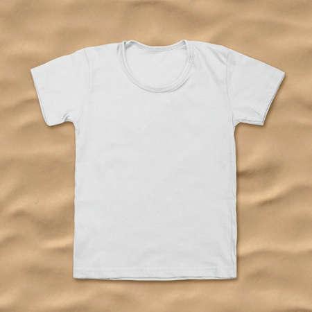 shirt: White blank t-shirt on sand background.