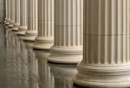 greek columns: Many old greek columns with reflection.