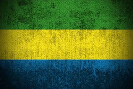 gabon: Weathered Flag Of Gabon, fabric textured   Stock Photo