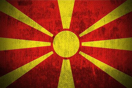 macedonia: Weathered Flag Of Macedonia, fabric textured   Stock Photo