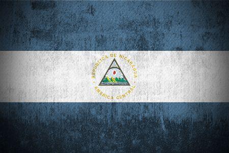 Nicaragua: Weathered Flag Of Nicaragua, fabric textured   Stock Photo