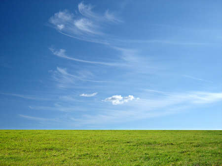 horison: blue sky and green grass for successful advertisement