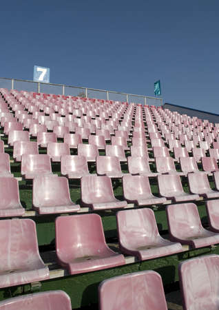 row of an empty seats and blue sky photo