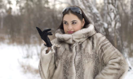 Young woman in a fur coat photo