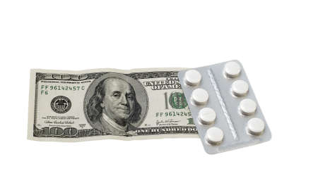 prescribed: pills and money on a white background