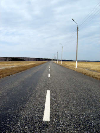 the  spring, dull road and sky with clouds Stock Photo - 2298533