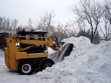 snow removal operation after strong snowfall in february� photo