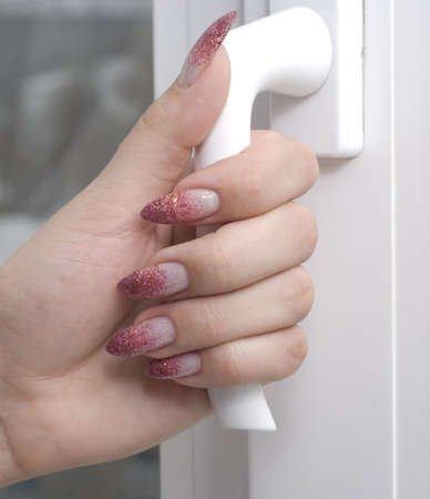 Hand opening a window or door Stock Photo - 2298561