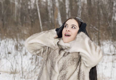 surprised girl in a fur coat Stock Photo - 2298571