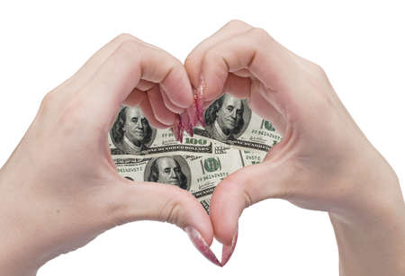 woman hands in the shape of a money heart Stock Photo - 2327780
