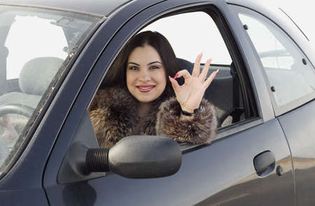 happy woman in the car Stock Photo
