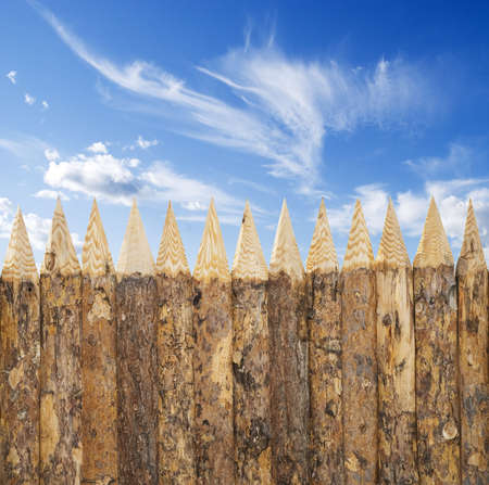 blue sky and wooden fence photo