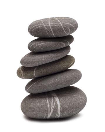balancing stones isolated on white photo