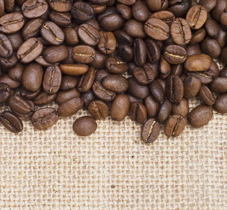 coffee beans on sackcloth background photo