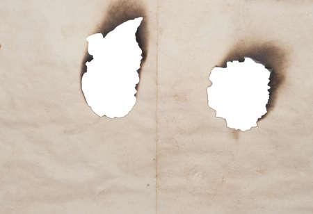 burnt holes isolated on white Stock Photo - 2824816