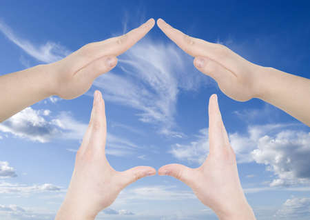 hand home gesture over sky background Stock Photo - 2862884