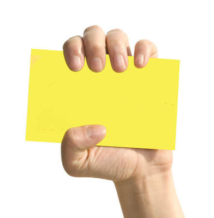 yellow card in woman hand isolated on white photo