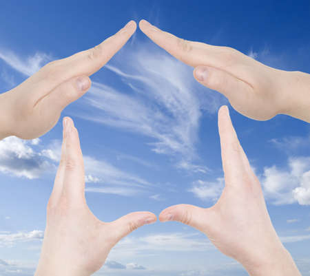 hand home gesture over sky background Stock Photo - 2911866