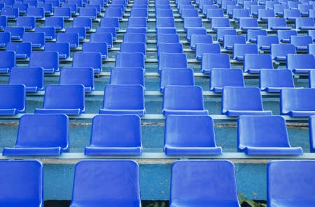 row an empty blue seats photo