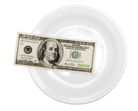 one hundred dollar in plate isolated on white photo