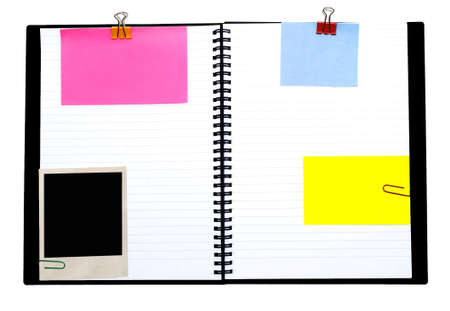 spiral notebook and empty notes isolated on white photo