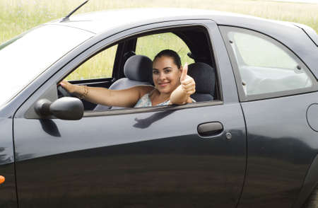 happy woman sitting in the car