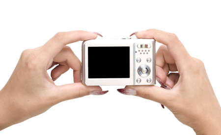 digital camera in a hands isolated on white photo