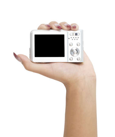 digital camera in a hand isolated on white photo