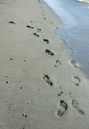 footprints on a sand beach photo