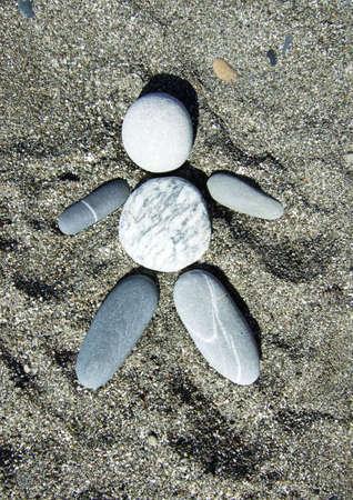 pebble man on a sand photo