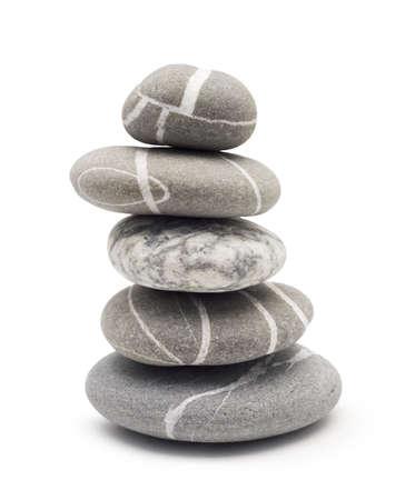 evenwichtssubsidie stenen geïsoleerd op wit Stockfoto